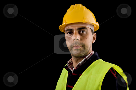 Worker stock photo, Young worker portrait in a black background by Rui Vale de Sousa