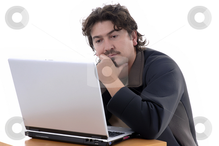 Working stock photo, Young casual man working with personal computer by Rui Vale de Sousa