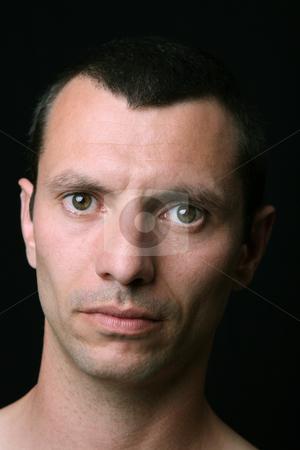 Portrait stock photo, Young man close up portrait, on black background by Rui Vale de Sousa