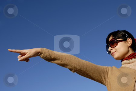 Pointing stock photo, Young casual woman with the sky as background by Rui Vale de Sousa