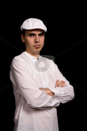 Casual stock photo, Young pensive man portrait, on a black background by Rui Vale de Sousa