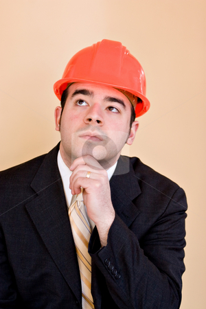 Contemplative Contractor stock photo, A man in a business suit and hard hat thinking about something. He could be a custom home builder or even an engineer or architect. by Todd Arena