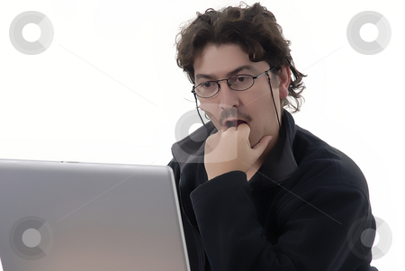 Working stock photo, Young man working with computer in a white background by Rui Vale de Sousa