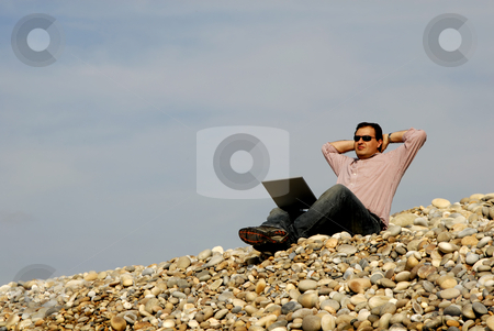 Relax stock photo, Young casual man with laptop at the beach by Rui Vale de Sousa