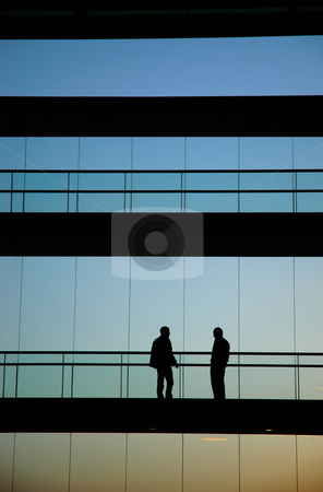Talk stock photo, Young business men in the office building by Rui Vale de Sousa