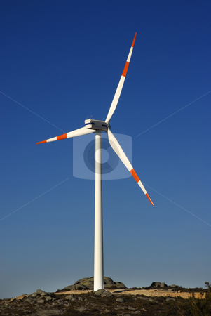 Turbine stock photo, Modern white wind turbine or wind mill producing energy by Rui Vale de Sousa