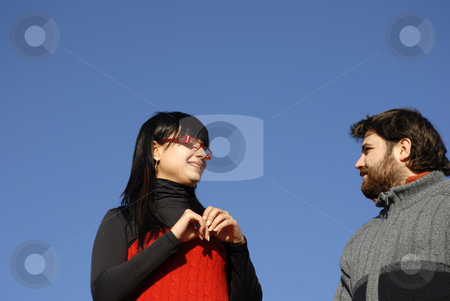 Love stock photo, Young happy couple with the sky as background by Rui Vale de Sousa
