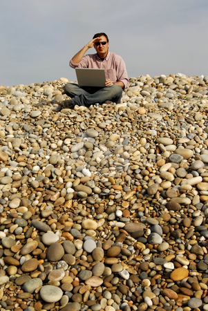 Wondering stock photo, Young casual man with laptop at the beach by Rui Vale de Sousa