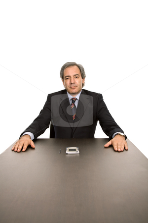 Boss stock photo, Mature business man on a desk, isolated on white by Rui Vale de Sousa