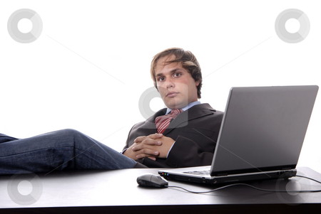 Wondering stock photo, Young man wondering while working with is laptop by Rui Vale de Sousa