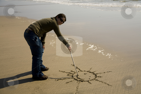 Drawing stock photo, Young woman drawing a sun at the beach by Rui Vale de Sousa