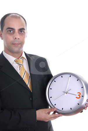 Holding stock photo, A handsome business man holding a clock by Rui Vale de Sousa