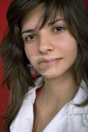 Young stock photo, Young woman portrait isolated on red background by Rui Vale de Sousa