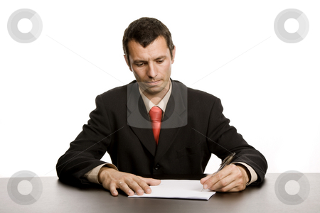 Writing stock photo, Young business man writing on a desk by Rui Vale de Sousa