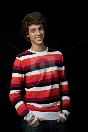 Happy man stock photo, Young casual man against a black background by Rui Vale de Sousa