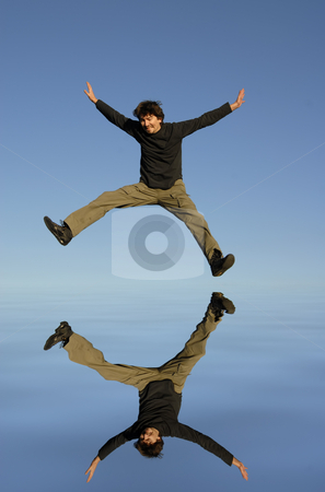 Jump stock photo, Young man jumps, water digitally worked reflection by Rui Vale de Sousa