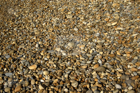 Stones stock photo, Small wet pebble stones at the beach by Rui Vale de Sousa