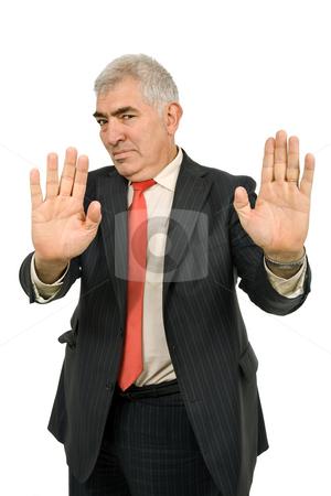 Halt stock photo, Business man making stop. Focus on the head by Rui Vale de Sousa