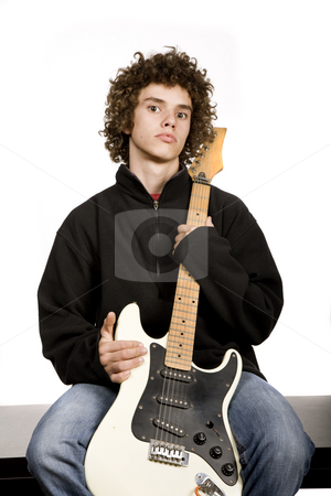 Musician stock photo, Young man musician with guitar, studio picture by Rui Vale de Sousa