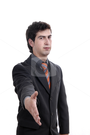 Offering stock photo, Young man in suit offering to shake the hand by Rui Vale de Sousa