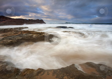 Tempestuous Seas stock photo, Ebb Tides flow back into a bowl formed by eroded limestone as the sun rises on Encounter Bay in South Australia by Mike Dawson