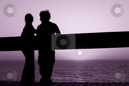 Love stock photo, Young couple in silhouette at the sunset by Rui Vale de Sousa