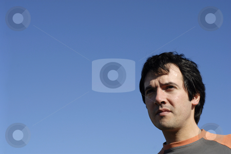 Man stock photo, Young casual man portrait with the sky as background by Rui Vale de Sousa