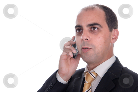 Speaking stock photo, Young business man speaking on a mobile phone by Rui Vale de Sousa
