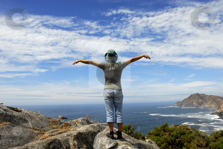 Wide open stock photo, Woman with arms wide open at the coast by Rui Vale de Sousa