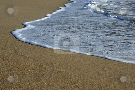 White wave stock photo, White wave in the sand at the beach by Rui Vale de Sousa