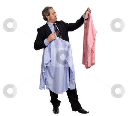 Choosing stock photo, Mature businessman choosing between two shirts, on white by Rui Vale de Sousa