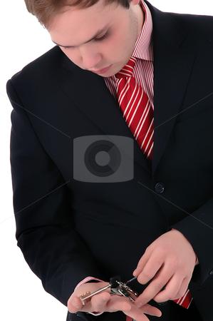 Keys stock photo, Young businessman holding keys close up portrait by Rui Vale de Sousa