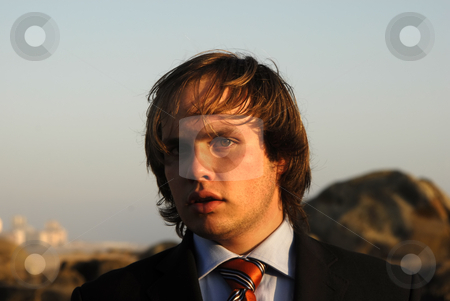 Young stock photo, Man portrait with suit outdoors in sunset light by Rui Vale de Sousa