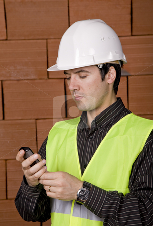 Engineer stock photo, Engineer with white hat with a brick wall as background by Rui Vale de Sousa
