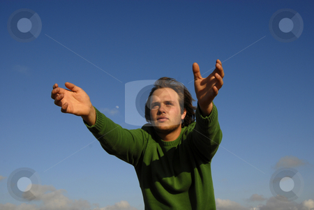 Hold stock photo, Man with open arms with the sky as background by Rui Vale de Sousa