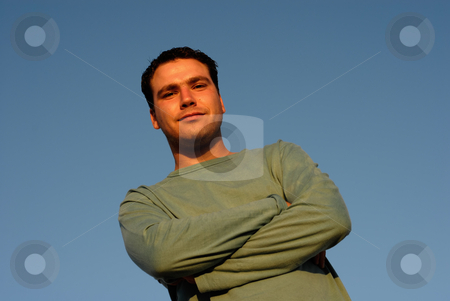 Male stock photo, Silly face young man with sky as background in sunset light by Rui Vale de Sousa