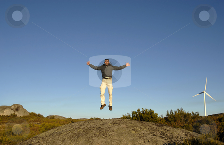 Man jumping up stock photo, Young man jumps high in the mountain by Rui Vale de Sousa