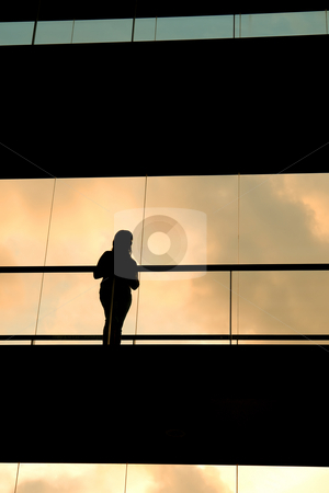 Silhouette stock photo, Woman in the modern buildind at sunset by Rui Vale de Sousa