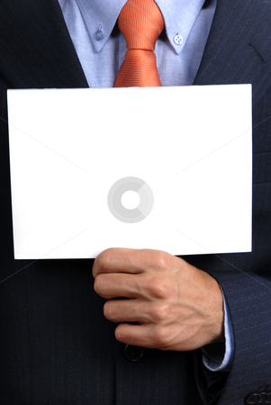 Holding stock photo, Business man holding a card in his chest by Rui Vale de Sousa