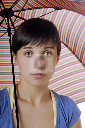 Umbrella stock photo, Young brunette girl with umbrella in colors by Rui Vale de Sousa