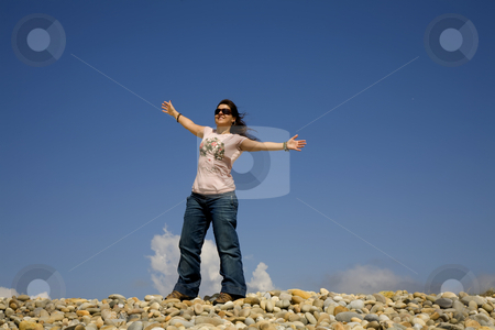 Woman stock photo, Woman at the beach with open arms and the sky by Rui Vale de Sousa