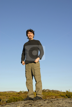 Waiting stock photo, Man on a rock and the sky as background by Rui Vale de Sousa