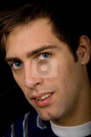 Close up stock photo, Young casual man against a black background by Rui Vale de Sousa