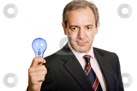 Lamp stock photo, Mature business man with a lamp isolated on white by Rui Vale de Sousa