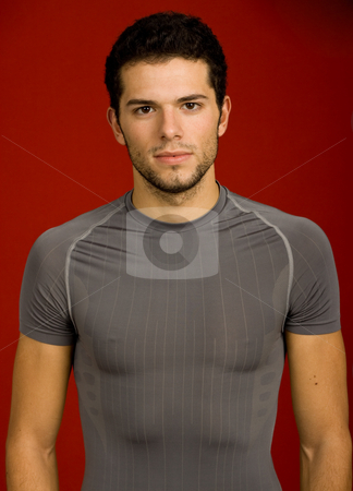 Sexy stock photo, Portrait of sexy young man, against red background by Rui Vale de Sousa