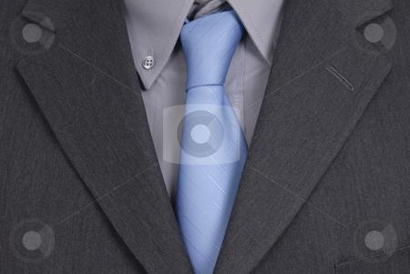 Tie stock photo, Detail of a Business man Suit with blue tie by Rui Vale de Sousa