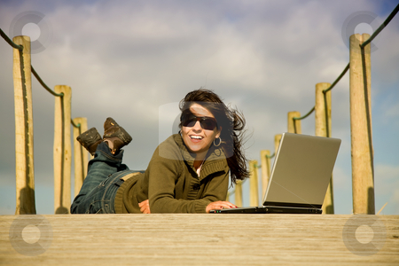 Woman stock photo, Young woman working with computer at the beach by Rui Vale de Sousa