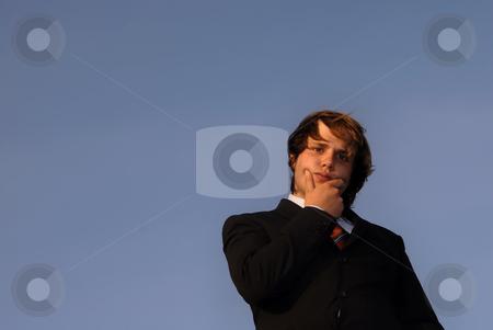 Pensive stock photo, Man in Business suit portrait in sunset light by Rui Vale de Sousa