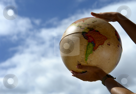 Globe stock photo, Globe in the woman hands and the sky by Rui Vale de Sousa