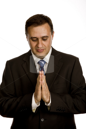 Prayer stock photo, Business man praying, isolated on white background by Rui Vale de Sousa